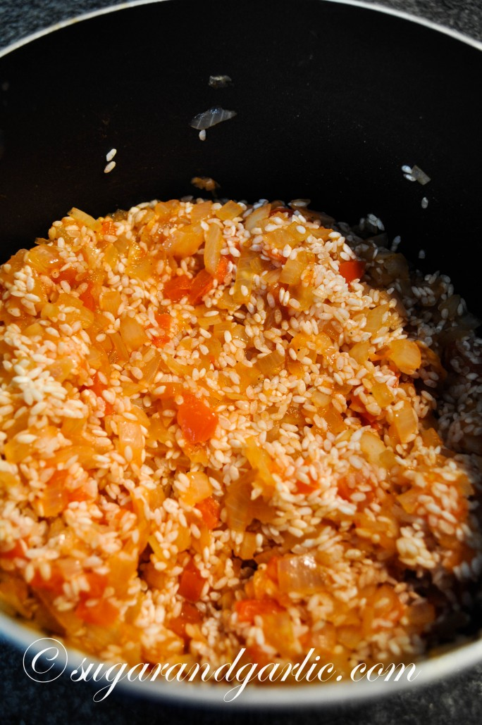 Stir in the rice and tomato paste.